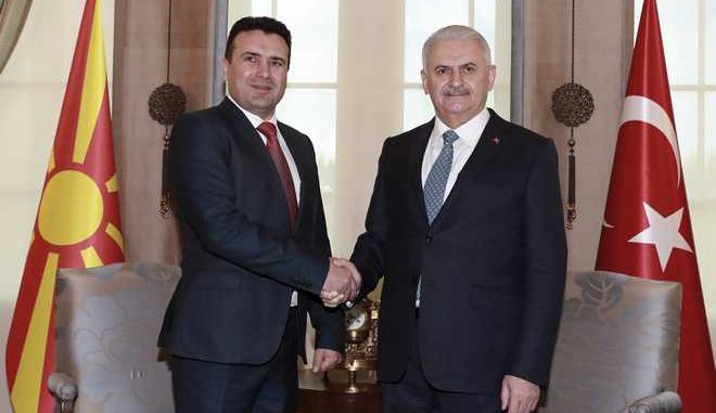 Turkey's Prime Minister Binali Yildirim, right, and Macedonia's Prime Minister Zoran Zaev shake hands before their talks at Cankaya Palace in Ankara, Turkey, Monday, Feb. 12, 2018. Zaev is in Turkey for an official visit.(Pool Photo via AP)