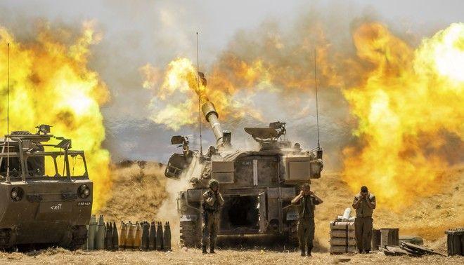 Iσραηλινή μονάδα πυροβολικού στοχεύει προς τη Λωρίδα της Γάζας, στα σύνορα της Γάζας και του Ισραήλ, την Τετάρτη 12 Μαΐου 2021