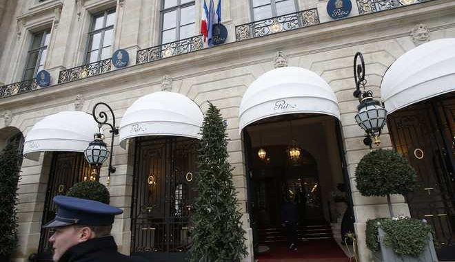 A valet waits outside the Ritz hotel in Paris, Thursday, Jan. 11, 2018. Paris police have recovered some jewels stolen from the Ritz Hotel in a multimillion-euro robbery attempt, but are still searching Thursday for two thieves and the rest of the missing luxury merchandise. (AP Photo/Michel Euler)