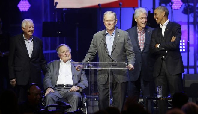 Former President George W. Bush, center, speaks as fellow former Presidents from right, Barack Obama, Bill Clinton, George H.W. Bush and Jimmy Carter look on during a hurricanes relief concert in College Station, Texas, Saturday, Oct. 21, 2017. All five living former U.S. presidents joined to support a Texas concert raising money for relief efforts from Hurricane Harvey, Irma and Maria's devastation in Texas, Florida, Puerto Rico and the U.S. Virgin Islands. (AP Photo/LM Otero)
