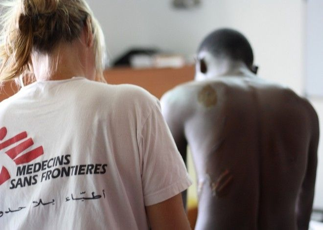 Dr Erna Rijnierse onboard the search and rescue vessel MV Aquarius treating violence-related injuries on Anon from Nigeria.   According to the people interviewed by our teams, men, women and, increasingly, unaccompanied children (some as young as 10 years old) transiting Libya are suffering abuse at the hands of smugglers, armed groups and private individuals. The abuses reported include being subjected to violence (including sexual violence), arbitrary detention in inhumane conditions, torture and other forms of ill-treatment, financial exploitation and forced labour.
