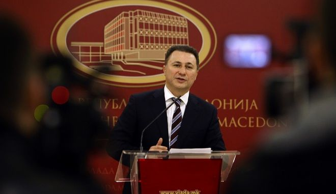 Macedonian Prime Minister Nikola Gruevski announces his resignation in front of the media, at the Government building in Skopje, Macedonia, Thursday, Jan. 14, 2016. Prime Minister Gruevski said he would submit his resignation to the speaker of parliament early Friday and the resignation would come into force one hundred days before the early elections. The resignation comes as a part of last year's Western-brokered deal to solve a deep political crisis triggered by a wiretapping scandal. (AP Photo/Boris Grdanoski)