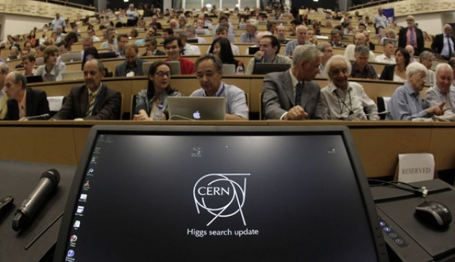Participants wait on July 4, 2012 before the opening of a seminar to deliver the latest update in the 50-year bid to explain a riddle of fundamental matter in the search for a particle called the Higgs boson at the European Organization for Nuclear Research (CERN) in Meyrin, near Geneva.                     AFP PHOTO / POOL / DENIS BALIBOUSEDENIS BALIBOUSE/AFP/GettyImages