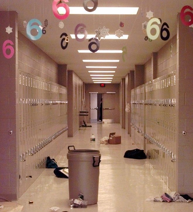 Backpacks and cleaning supplies lie in the hallway of Westside Middle School in Jonesboro, Ark., Wed., March 25, 1998. The view is from a door used by students to leave the building during a false fire alarm Tuesday. Two boys hidden in a wooded area opened fire on the students leaving the school, killing four girls and one teacher and injuring 11 others. (AP Photo/Mark Humphrey)