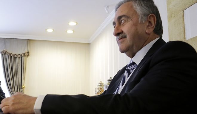 Turkish Cypriot leader Mustafa Akinci, right, U.N. Special Advisor of the Secretary-General Espen Barth Eide are seen during a meeting in the Turkish Cypriot breakaway north part of Nicosia, Cyprus, Wednesday, May 24, 2017. Eide says he's working to get the rival leaders of ethnically divided Cyprus to agree by the end of this week on holding a final summit that'll aim to conclude an overall reunification deal. (AP Photo/Petros Karadjias)