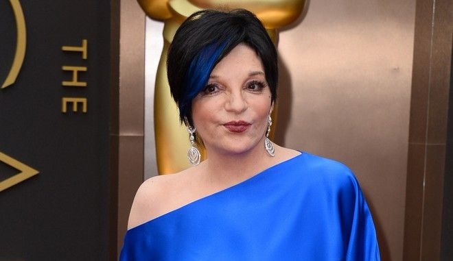 FILE - In this March 2, 2014 file photo, Liza Minnelli arrives at the Oscars in Los Angeles.  Minnelli has checked herself in rehab and is making excellent progress, according to her representative on Wednesday, March 18, 2015. Minnelli has valiantly battled substance abuse over the years and whenever she has needed to seek treatment she has done so. (Photo by Jordan Strauss/Invision/AP, File)