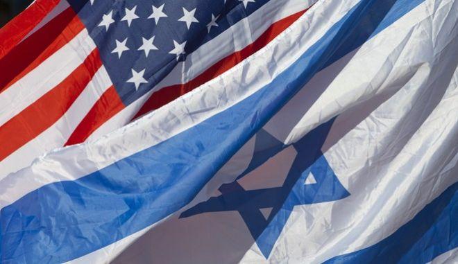 U.S. and Israeli flags fly as U.S. Secretary of State John Kerry arrives in Tel Aviv, Israel, Tuesday, Nov. 24, 2015. (AP Photo/Jacquelyn Martin, Pool)