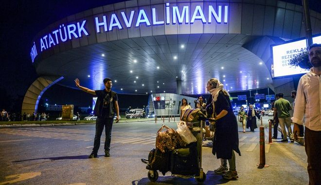 People leave Istanbul's Ataturk airport, Tuesday, June 28, 2016. Two explosions have rocked Istanbul's Ataturk airport, killing several people and wounding others, Turkey's justice minister and another official said Tuesday. A Turkish official says two attackers have blown themselves up at the airport after police fired at them. The official said the attackers detonated the explosives at the entrance of the international terminal before entering the x-ray security check. Turkish authorities have banned distribution of images relating to the Ataturk airport attack within Turkey. (AP Photo) TURKEY OUT