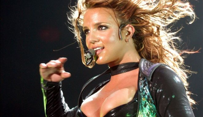 Singer Britney Spears performs during her concert in Frankfurt's Festhalle Friday May 14, 2004, during her European 'The Onyx Hotel Tour 2004'. (AP Photo/Bernd Kammerer)