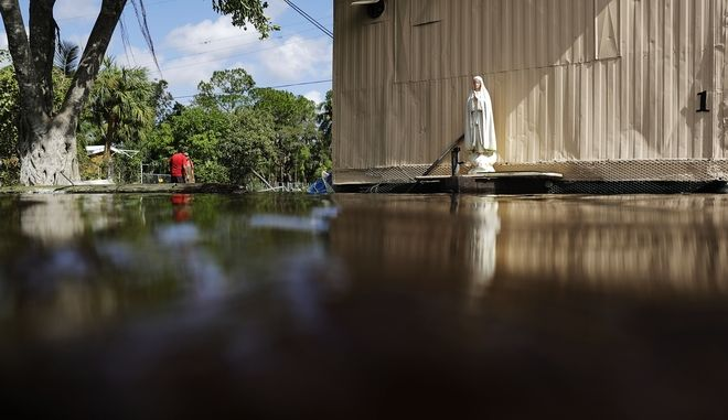 A statue of the Virgin Mary attached to a mobile home stands above the flood waters in the aftermath of Hurricane Irma in Bonita Springs, Fla., Tuesday, Sept. 12, 2017. (AP Photo/David Goldman)