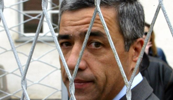 FILE - In this Saturday, Oct. 23, 2004, file photo of Kosovo Serb politician Oliver Ivanovic in the northern, Serb-dominated part of Mitrovica, Kosovo. Judges of the EU's justice mission in Kosovo on Thursday Jan. 21, 2016 found Ivanovic guilty of murder and torture of ethnic Albanians in 1999 during Kosovo's war for independence from Serbia. (AP Photo/Darko Vojinovic, file)