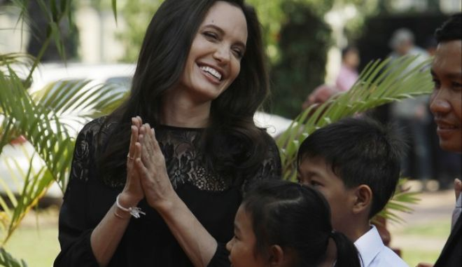 """Hollywood actress Angelina Jolie smiles before a press conference in Siem Reap province, Cambodia, Saturday, Feb. 18, 2017. Jolie on Saturday launches her two-day film screening of """"First They Killed My Father"""" in Angkor complex in Siem Reap province. (AP Photo/Heng Sinith)"""