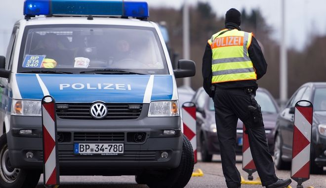 Police controls cars at a checkpoint near the Belgian-German border on highway 44 near Aachen, Germany Wednesday March 23, 2016. Germany has increased security measures  following the attacks in the Belgian capital, Brussels, on Tuesday. ( Marius Becker/dpa via AP)