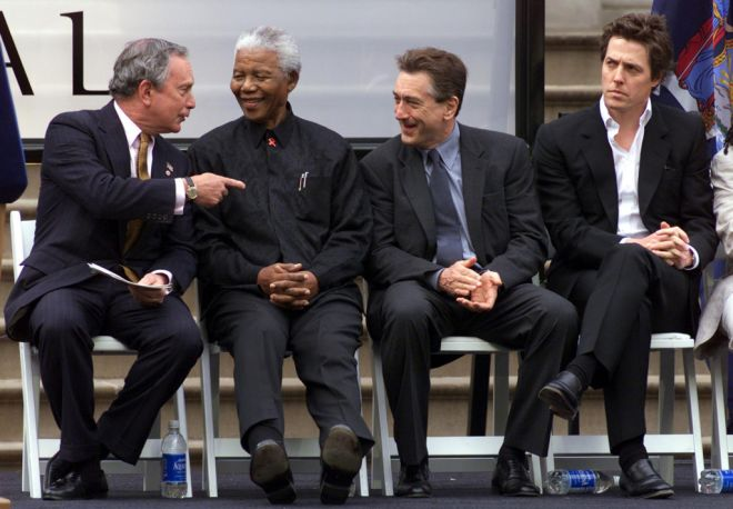 Former South African President Nelson Mandela (2-L) listens to New York City Mayor Michael Bloomberg (L) as actors Robert DeNiro (C) and Hugh Grant (R) sit with him at an event at New York's City Hall to launch the First Annual Tribeca Film Festival, May 8, 2002. The festival, which will showcase world premiere and independent films, was co-founded by DeNiro and Jane Rosenthall and will open with the premiere of the film