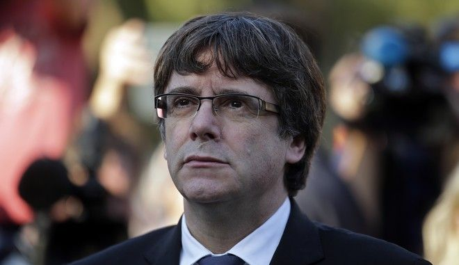Catalan regional President Carles Puigdemont attends a ceremony commemorating the 77th anniversary of the death of Catalan leader Lluis Companys at the Montjuic Cemetery in Barcelona, Spain, Sunday, Oct. 15, 2017. Catalonia's separatist movement is being threatened by infighting over strategy to culminate its long-held desire to break away from Spain. Die-hard separatists are pushing for a definitive declaration of independence in the next few days. (AP Photo/Manu Fernandez)