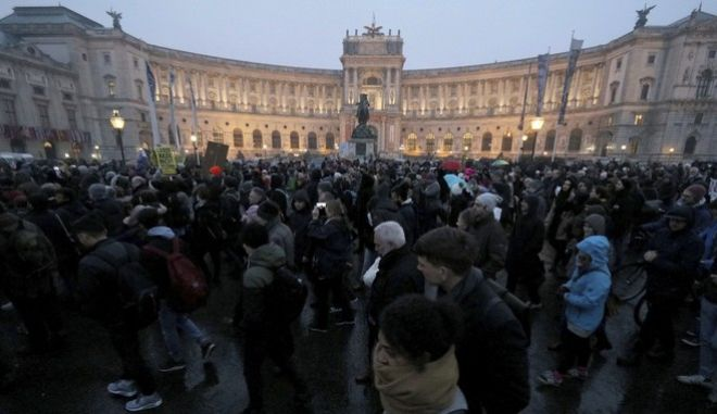 Protesters walk during a demonstration against the new Austrian government in front of the Hofburg palace in Vienna Austria, Saturday, Jan. 13, 2018. (AP Photo/Ronald Zak)