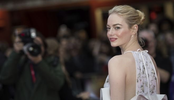 Actress Emma Stone poses for photographers upon arrival at the premiere of the film 'Battle of the Sexes' during the London Film Festival in London, Saturday, Oct. 7, 2017. (Photo by Vianney Le Caer/Invision/AP)