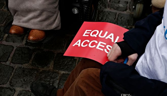 Members from European Disability Forum take part in a protest in front of the European Parliament calling on the Internal Market Committee of the European Parliament to adopt a more ambitious position on this important proposal for legislation and make it meaningful for millions of people in Europe in Brussels, Belgium on Mar. 6, 2017 /             .                 .    6 , 2017