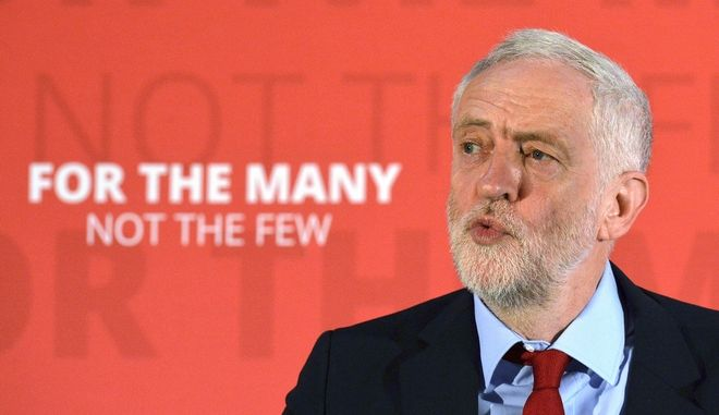 Britain's Labour Party leader Jeremy Corbyn delivers a speech where he outlined his party's industrial strategy to deliver jobs and strengthen the economy while on general election campaign trail in York northern England Friday June 2, 2017. (Anna Gowthorpe/PA via AP)