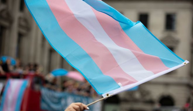 A transgender flag being waved at LGBT gay pride march