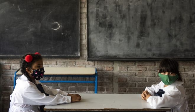 Students attend their first day back to in-person class amid the COVID-19 pandemic at a public school in Montevideo, Uruguay, Monday, March 1, 2021. Uruguay is returning most of its students to in-person classes after the summer holidays. (AP Photo/Matilde Campodonico)