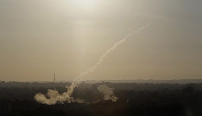 FILE - In this Aug. 9, 2014 file photo, a rocket is fired from Gaza City towards Israel. The human rights group Amnesty International said in a report Thursday March 26, 2015, that Palestinian militant organizations had committed war crimes during the 2014 Gaza-Israel conflict, for killing both Israeli and Palestinian civilians using indiscriminate projectiles. (AP Photo/Dusan Vranic, File)
