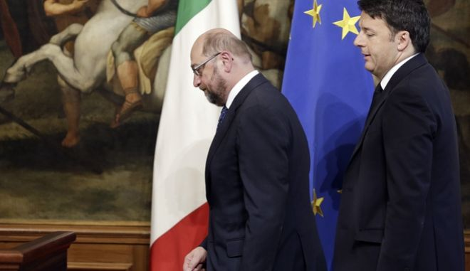 European Parliament President Martin Schulz, left, and Italian Premier Matteo Renzi arrive for a joint press conference at the end of their meeting in Rome's Chigi Palace government office, Friday, Feb. 12, 2016. (AP Photo/Alessandr Tarantino)