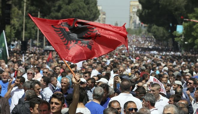 Supporters of Albania's main opposition take part in a protest demanding a caretaker cabinet to take the country to the June 18 parliamentary election, on Saturday, May 13, 2017. Several thousand supporters walked peacefully along Tirana's main Martyrs of the Nation boulevard to Prime Minister Edi Rama's office, guarded by hundreds of policemen. (AP Photo/Hektor Pustina)