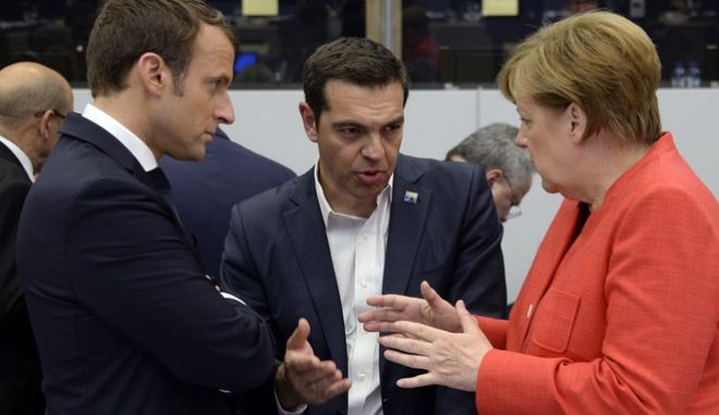 German Chancellor Angela Merkel, right and Greek Prime Minister Alexis Tsipras, centre  gesture as they speak with French President Emmanuel Macron, during the NATO summit of heads of state and government, at the NATO headquarters, in Brussels on Thursday, May 25, 2017. US President Donald Trump inaugurated the new headquarters during a ceremony on Thursday with other heads of state and government. (Thierry Charlier/Pool Photo via AP)